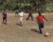 Children orphaned by Ebola in West Africa play soccer.