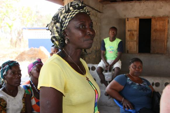Farmer Safiatu Bockari explains that months of Ebola quarantines in Sierra Leone have depleted seed stores and she worries that there will be a food shortage. Photo by Jill Costello, United Methodist Communications.