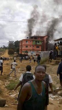 A hotel in Ganta, Liberia, was set ablaze by an angry mob. Reports of violence in northern Liberia have been on the rise. Photo courtesy of Julu Swen, UMNS