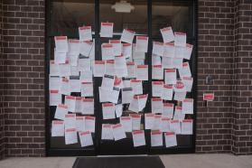 Petitions supporting changing the church's stance on homosexuality are taped to a bishop's door  in a demonstration meant to invoke Martin Luther's famous posting of the 95 Theses to the Wittenberg Castle Church door. Photo courtesy of Reconciling Ministries Network