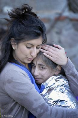 Zoya Hameed (left), a physician from the United Kingdom, hugs Hanin, a frightened Syrian refugee girl, on a beach near Molyvos, on the Greek island of Lesbos, on Oct 30,. 2015. The girl was on a boat full of refugees that traveled to Lesbos from Turkey. Hameed is one of hundreds of volunteers on the island who receive the refugees and provide them with warm clothing and medical care before they continue their journey toward western Europe.