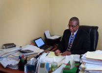 Johnson N. Gwaikolo works his office at United Methodist University in Liberia.  Gwaikolo is the new university president as appointed by Bishop John G. Innis. Photo by Julu Swen, UMNS