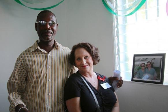 Karen Gardner (left) was among the Highland Park United Methodist Church volunteers injured in Petit-Goâve, Haiti during the 2010 earthquake. She returned in January 2014 for the dedication of the church's new eye clinic building and posed with Ruben, a Haitian man who helped rescue her. File photo courtesy of Highland Park United Methodist Church