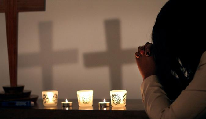 United Methodists are praying after the deadly church shooting at Emanuel African Methodist Episcopal Church in Charleston, S.C. Photo illustration by Kathleen Barry, United Methodist Communications