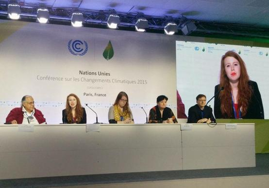 Kirby Fullerton, second from left, a United Methodist from Little Rock, Ark., speaks on a human rights press conference panel during the Paris climate summit. A student at the University of Edinburgh in Scotland, Fullerton attended as part of the UK Youth Climate Coalition's delegation. Photo courtesy of Kirby Fullerton