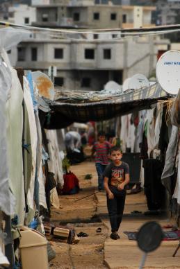 A Syrian boy walks through a refugee camp in Lebanon. Photo courtesy of Dan Bracken