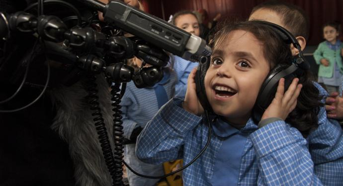 A Syrian girl at a school in the refugee camp of Bourj el-barajneh in Beirut has fun with the