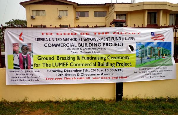 Banner announces the ground breaking ceremony before the UMC Liberia.