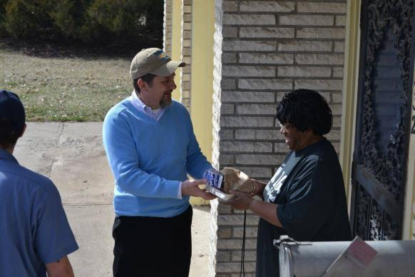 The Rev. Mark Holland joins a Meals on Wheels route in Kansas City, Kansas. He's pastor of Trinity Community Church, a United Methodist congregation, as well as mayor of Kansas City, Kansas. Photo courtesy Mark Holland