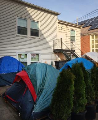 McMinnville Cooperative Ministries, a joint United Methodist-Lutheran church, says it's following its mission by letting homeless people camp there. But the city of McMinnville, Oregon, has had complaints from the church's neighbors, and has ordered the encampment closed by March 31st. Photo McMinnville Cooperative Ministries.