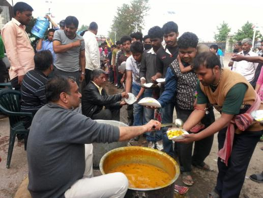 Community kitchens set up around Kathmandu to feed earthquake survivors. Here, volunteers from Marwari Sewa Samiti distribute cooked meals in the Tudikhel section, serving about 5,000 a day. Photo courtesy of ACT Alliance
