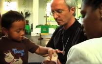 The Rev. Shawn Moses Anglim serves communion at First Grace United Methodist Church in New Orleans.