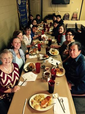 On the first day of their reunion, members of both Clinton and Providence United Methodist churches enjoy lunch after worship. Becky Yates, outreach director at Providence, is on the far left, and the Rev. David Wilson, Oklahoma Indian Missionary Conference superintendent, is on the far right. Photo by Donna Pewo