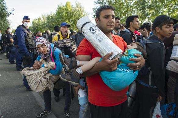 Refugees are halted on the way to a registration center in Hungary by the Serbian border.  Photo © UNHCR/Mark Henley