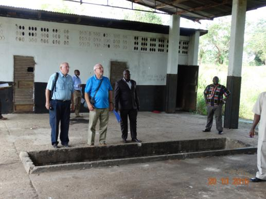 A consulting team tours the Taiama Secondary School campus to look at some of the unused property which could be renovated for the proposed academy. Photo by Phileas Julu, UMNS