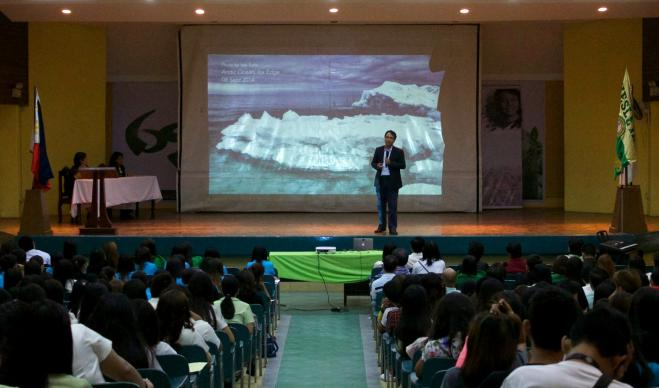 Naderev M. Sano, commissioner of the Philippines Climate Change Commission, lectures during a Climate Justice forum held at Wesleyan University-Philippines located in  Cabanatuan City. Photo by Gladys Mangiduyos