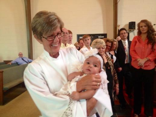 The Rev. Shelly Nichols has done baptisms as a licensed local pastor at Cross Lanes United Methodist Church, including little Jocelyn Jarrett on August 31, 2014. Photo courtesy Shelly Nichols
