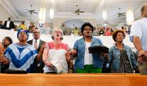 About 150 people, including United Methodists, attended a June 19 ecumenical prayer service at St. John's African Methodist Episcopal Church in Montgomery, Ala., in response to the church shootings at Emanuel AME Church in Charleston, S.C. Photo by Luke Lucas