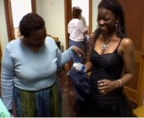 Teen shops for prom dress at Union Ridge UMC clothes closet. Video image by United Methodist Communications.
