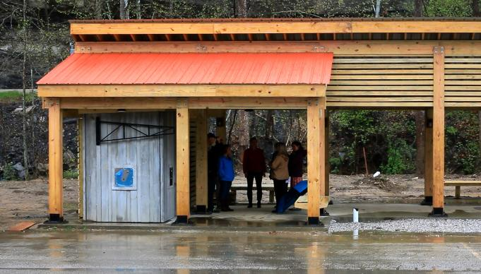 Nursing students from the University of Tennessee, staff of Red Bird Mission and visitors stand under the shelter of the water kiosk scheduled to open later this summer.
