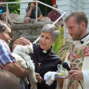 Ginny Mikita helps at a blessing of the animals with the Rev. Benjamin Hutchison at Cassopolis (Mich.) United Methodist Church. Mikita remains a certified candidate to become a deacon after officiating at Hutchison's wedding using online credentials. Photo courtesy of Mikita