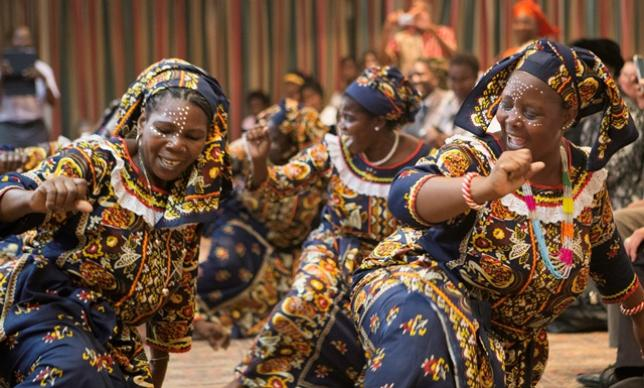 United Methodist women present a traditional dance from northern Mozambique during a meeting of the Standing Committee on Central Conference Matters and Connectional Table. Photo by the Rev. Rodney Steele