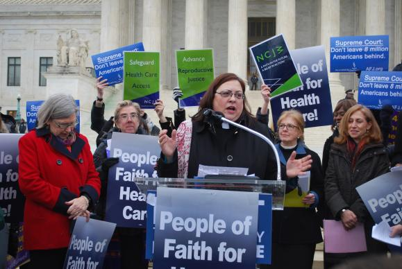 The Rev. Cynthia Abrams, director of health and wholeness at the United Methodist Board of Church and Society, speaks during a February rally for health care in front of the U.S. Supreme Court. Over Abrams' left shoulder is the Rev. Susan Henry-Crowe, top executive of the agency. A 2015 file photo courtesy of United Methodist Board of Church and Society.