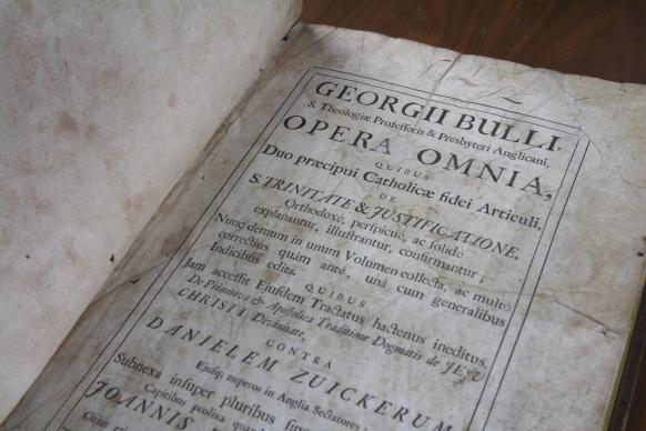 """Rare books from predecessor Methodist publishing operations have ended up at The United Methodist Publishing House in Nashville. This 1703 edition of """"The Works of George Bull"""" is one example. Photo by Kathleen Barry, United Methodist Communications"""
