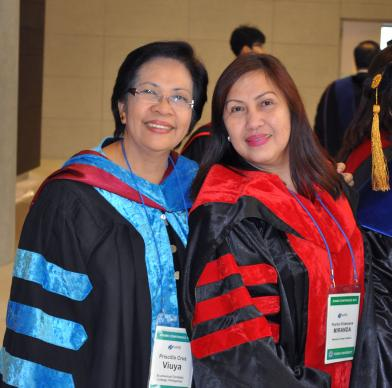 Priscilla Viuya, left, and Florita Villanueva Miranda at the meeting of the Asia-Pacific Association of Methodist-related Educational Institutions in Incheon, Korea. Photo by Kimberly Lord, GBHEM
