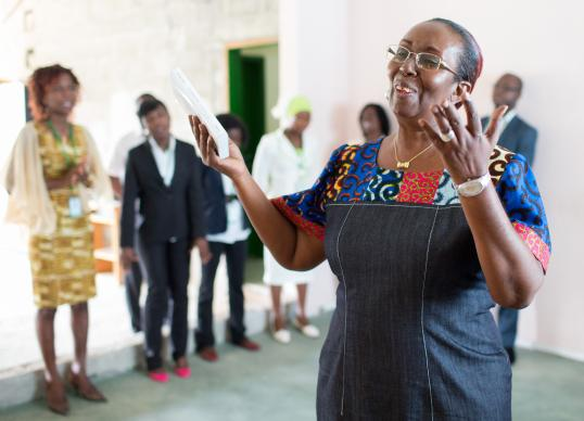 Lydie Acquah, director of The United Methodist Church's Voice of Hope radio station in Abidjan, Côte d'Ivoire, leads a devotional service for station staff. Photo by Mike DuBose, UMNS