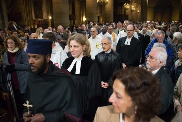 Religious leaders on Dec. 3, 2015, take part in an ecumenical celebration for creation at the Cathedral of Notre Dame de Paris during the COP21 climate talks taking place in nearby Le Bourget. Photo courtesy of the World Council of Churches