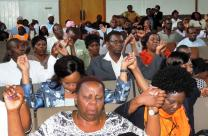 Worshippers at Harare's Trinity Methodist Church unite hands in prayer at prayer meeting about xenophobia in South Africa. Photo by Taurai Emmanuel Maforo, UMNS
