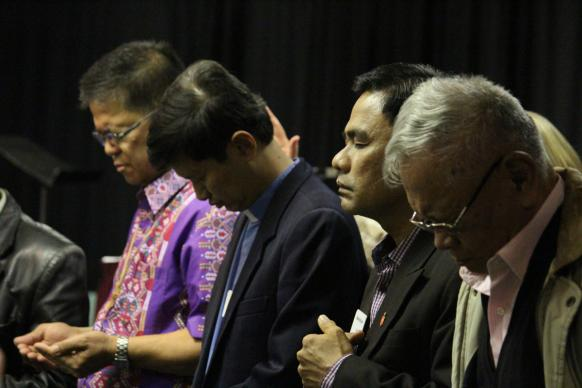 In this November 2013 file photo, Bishops Ciriaco Francisco, Pedro M. Torio, Jr., Rodolfo Alfonso Juan and Emerito Nacpil (retired) pray for those affected by Typhoon Haiyan during a Council of Bishops meeting. Francisco, Torio and Juan are all running for re-election when the Philippines Central Conference meets Nov. 28-Dec. 4.