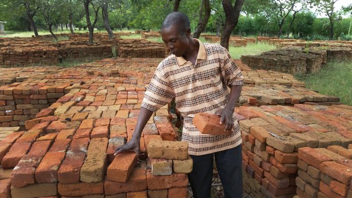 Hamadziripi Nyakudanga is satisfied with the quality of the 60 0000 bricks provided by the community for expanding and upgrading Dendera Clinic. Photo by Eveline Chikwanah, UMNS