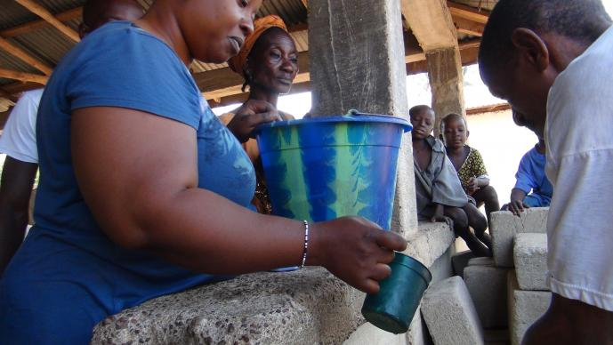 At a community gathering in Tilorma village, Kenema district, Sierra Leone, hand-washing became routine after the outbreak of Ebola. The virus has killed nearly 4,000 people in Sierra Leone.