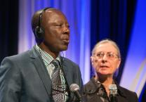 Stanislas Kassongo (left) takes part in a panel discussion during the pre-General Conference briefing in Portland, Ore. Kassongo is a delegate to the 2016 United Methodist General Conference from the Central Congo Episcopal Area. Isabelle Berger (right) is a French interpreter from the denomination's Board of Global Ministries.