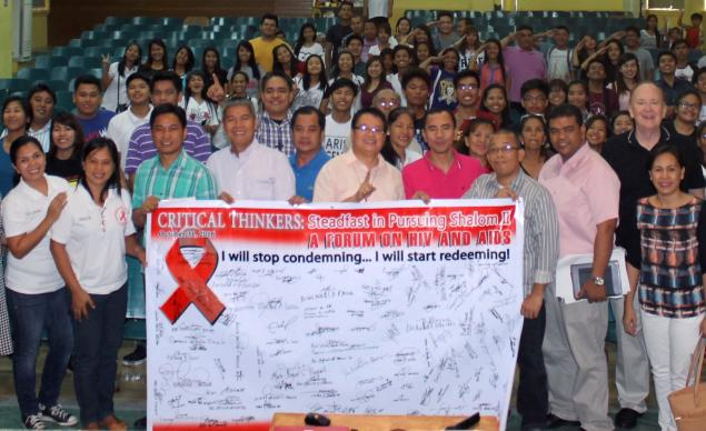 Participants of the HIV/AIDS forum in the Philippines pose during the event. The Rev. Donald Messer (second from right), top executive for the Center for Health and Hope and member of the executive committee for the United Methodist Global AIDS Fund, was a speaker. Photo by Gladys P. Mangiduyos, UMNS.