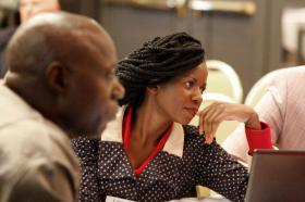 Miracle Osman (center) of the Malawi Provisional Conference takes part in a discussion during the United Methodist Connectional Table meeting in Jacksonville, Fla. Photo by Kathy L. Gilbert, UMNS.