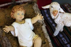 Baby Jesus and lamb nativity figures. Photo by Kathleen Barry, United Methodist Communications