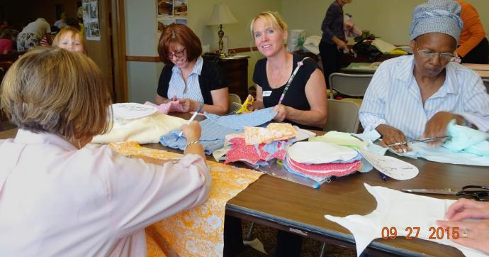 Volunteers with The Nyadire Connection prepare Empowerment Pad kits at sewing parties in Pittsburgh, Pennsylvania. Photo courtesy Bonnie Lawson.