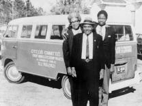 Esau Jenkins, center, stands in front of one of the VW vans he and his wife, Janie, bought to ferry African-American residents of Johns Island to work or school in Charleston, S.C. During the trip, they would teach their passengers the part of the Constitution they needed to know in order to register to vote. Photo courtesy of Elaine Jenkins.