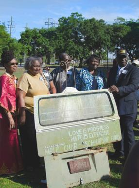 Marking the 2014 send-off of the back panel of the VW bus owned by their father, Esau Jenkins, to the Smithsonian were, from left, Elaine Jenkins, Francena J. Buncomb, Lorretta J. Saunders, James Jenkins, Marie J. Jones and Abraham Bill Jenkins, Sr. The panel is part of a permanent exhibit at the new National Museum of African American History and Culture. Photo courtesy of Elaine Jenkins.