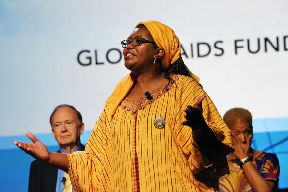 The Rev. Anne Gatobu from the Global AIDS Fund speaks during the 2016 United Methodist General Conference May 18 in Portland, Ore. In the background are the Rev. Donald Messer and the Rev. Joan Carter-Rimbach. Photo by Kathleen Barry, UMNS