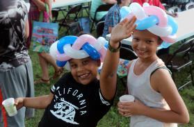 Children at Aldersgate United Methodist Church enjoy their balloon animal hats. Photo by David Burke