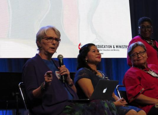 The Rev. Anne Leighton Burkholder, of Candler School of Theology, speaks during an Aug. 30 panel discussion on women and theological education at the Global United Methodist Clergywomen's Gathering in Houston. Photo by Sam Hodges, UMNS