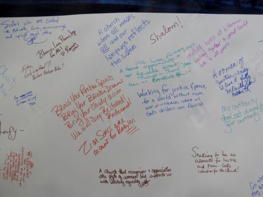 A banner records handwritten messages from those attending the Global United Methodist Clergywomen's Gathering in Houston, Aug. 29-31. Photo by Sam Hodges, UMNS