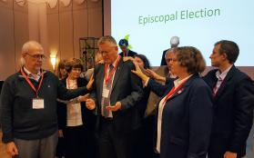 United Methodists pray with Bishop Christian Alsted, who has been re-elected to lead the church in northern Europe. His area includes Denmark, Norway, Finland (two annual conferences), Estonia, Latvia and Lithuania. Photo by Karl Anders Ellingsen, UMNS.