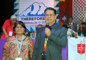Bishop Ciriaco Q. Francisco, accompanied by his wife, Restetita Victoria, spoke Dec. 2 to delegates at the Philippines Central Conference after his re-election as a bishop in The United Methodist Church.  Photo by Gladys Mangiduyos, UMNS.