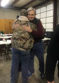 Bishop Bill McAlilly hugs the Rev. Tommy Flood from Lutts United Methodist Church in Lutts, Tenn.  Photo by Abigail Overstreet