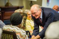 After worship services in the Bethany memory care unit, retired United Methodist Bishop Kenneth Carder goes around the room, greeting each resident by name. Carder is serving as interim chaplain at Bethany, part of the Heritage at Lowman senior community near Columbia, S.C. Photo by Matt Brodie.